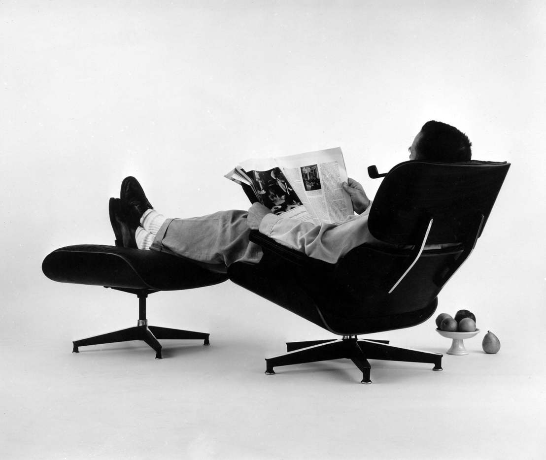 3-charles-eames-in-the-plywood-lounge-and-ottoman.-photograph-for-an-advertisement1956